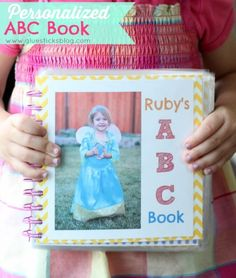 """Personalized ABC Book: what better way to learn the ABC's than to have all of your favorite things put into a book? My daughter loves hers and brings it everywhere. """"T"""" is for Toby (her dog) etc."""