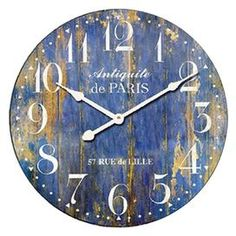 """Weathered wood wall clock with a plank-style face and typographic motif.  Product: Wall clockConstruction Material: MDFColor: Distressed blueFeatures: Plank-style faceAccommodates: Batteries are not includedDimensions: 23"""" Diameter x 0.5"""" D"""