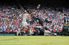 Gentlemen's Semi-Finals: Federer vs. Raonic: Roger Federer goes after a forehand on Centre Court - Day 11
