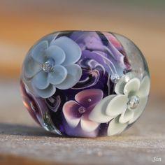 Handmade glass lampwork bead with flower pattern. (24 x 21 mm).