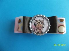Pink and Brown  Bow with Tiger Bottle Cap by ang744 on Etsy, $2.50