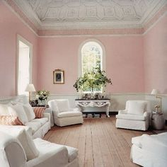 Light pink walls, natural wood plank floors.