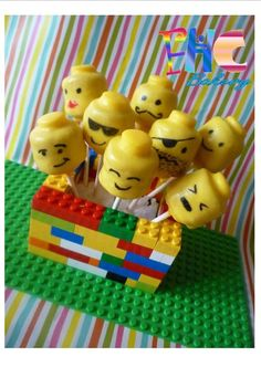 Lego head cake pops. love the base made of legos