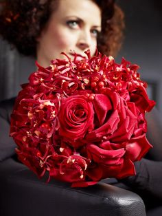 Seductive bouquet of red roses and james storey orchids. marrymania.net