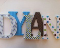 Nursery wooden wall letters Blue , green and brown themed letters SummerOlivias Wooden Letter Crafts, Wooden Letters For Nursery, Name Crafts, Painting Wooden Letters, Cardboard Letters, Diy Letters, Painted Letters, Wood Letters, Hand Painted