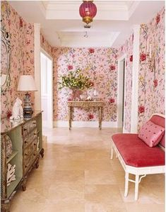 Fabulous foyer with pink chinoiserie wallpaper and a pink velvet loveseat.