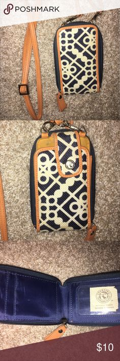 Wallet/purse Blue, white, orange wallet with full around zipper and long cross-body strap. Natural linen genuine leather. Used for a football season at games. 3 card slots and 1 clear slot. Button closure phone section. Spartina Bags Clutches & Wristlets