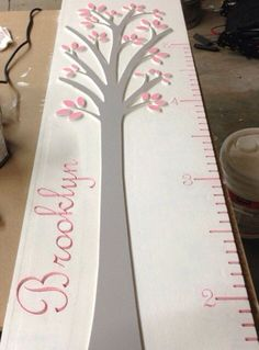 Kids growth chart on Etsy, $55.00 - i like the tree part for once! And it could say family
