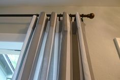 Cheap and easy curtain tutorial made from flat sheets.  My homemade curtains get more compliments then my bought ones.