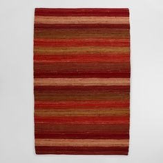 Loomed by village weavers in India, our cotton rag rugs contain slight variations in design and coloration, an indication of their unique handmade origins. Our Persimmon Pebble Chindi brings instant warmth to a room with a burst of red and orange shades. An attractive décor element and soft to the touch.
