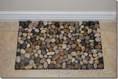 Make your own Rock Door Mat... my dollar store has bags of rocks.... this could be a really inexpensive craft!!