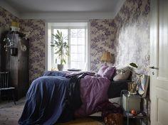 Bedroom with purple wallpaper