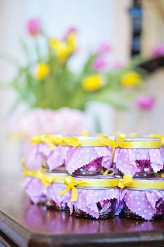So cute for a spring baby shower.  Small mason jars filled with Hershey caramel kisses!