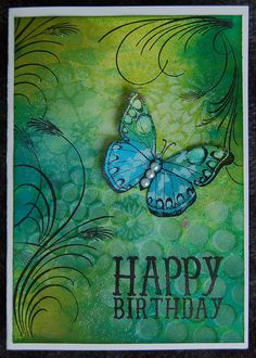 Dylusions ink spray, distress ink and templates. Stamps used are Hero Arts Stamps: