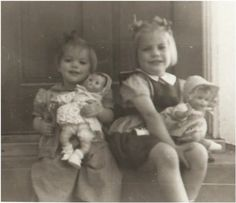 Adorable vintage photo of two little girls, Karen and Margaret Harrison, with their dolls, circa 1940-1950's.
