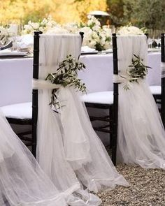 Easy chair back covers made using tulle purchased by the bolt, add flowers and ta-dah!!!