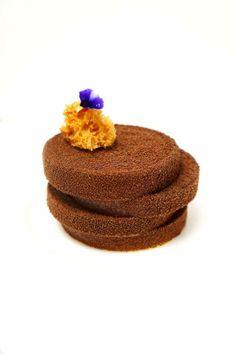 Birthday Cake For My Sister BASE: Hazelnut Daquoise INCLUSION 1: Passion Fruit Mousse INLCUSION 2: Valrhona Guanaja Cremeux BODY: Valrhona Dulcey Salted Pop Rocks COATING: Dark Brown Velvet Spray GARNISH: Caramel M Sponge