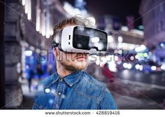 Man wearing virtual reality goggles. Night city.
