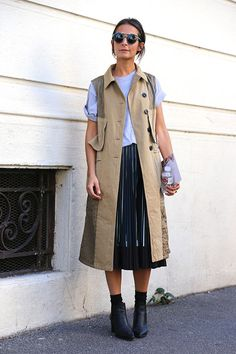 Street-style snap: Michaela is spotted on the streets of #MFW in a trench-inspired vest that is awesomely utilitarian and chic at the same time. It pairs well with her grey tee and adds counterbalance to her feminine pleated skirt. #nordstrom
