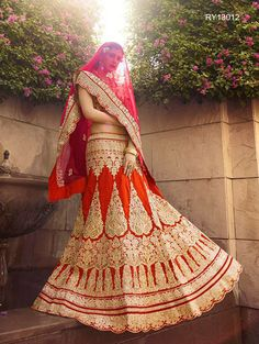 Buy Designer Bridal Lehengas, Wedding Lehengas Online : Look like a star wearing this orange and red raw silk unstitched lehenga choli spruced up with intricate zari work. Paired with a matching dupatta. It can be customized upto size 42. *Call / Whatsapp / Viber : +91-9052526627 *Email : customercare@natashacouture.com *Worldwide Shipping | Free shipping in India | Cash on delivery *