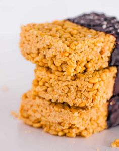 Healthy rice crispy treats with peanut butter. Fuss-free, protein-packed and whipped together in just under 5 minutes. They are made without marshmallows or butter, partially dipped in dark chocolate, then sprinkled with fleur de sel for a surprisingly good finishing touch. #Vegan #vegetarian #dairy-free #gluten-free #egg-free #protein #snack. | onecleverchef.com
