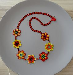 Red, Orange and Yellow Flowers - Long Mexican Necklace - Peyote beaded - handmade by Luciana Lavin by LucianaLavin on Etsy Beaded Jewelry Patterns, Beading Patterns, Picture Necklace, Beaded Necklace, Beaded Bracelets, Mexican Jewelry, Peyote Beading, Beads And Wire, Beaded Flowers