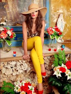 Cheryl Cole. Canary Yellow Skinny Pants with Red Pumps & thatch neutral hat.