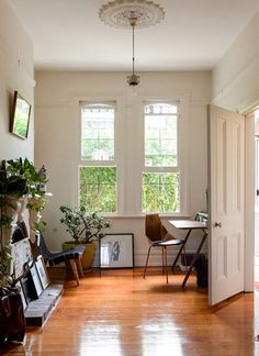 white walls, wood floors, plants