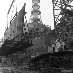 """Construction of the """"sarcophagus"""", a concrete roof over the destroyed Chernobyl reactor, to protect the environment for 30 years. Chernobyl 1986, Chernobyl Disaster, Chernobyl Today, Abandoned Buildings, Abandoned Places, Chernobyl Reactor 4, Nuclear Apocalypse, Chernobyl Nuclear Power Plant, Nuclear Disasters"""