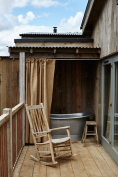 A bath outside one of the cabins at Soho Farmhouse in Great Tew, Oxfordshire. Photo by: Tim Evan-Cook