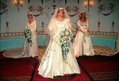 Princess Diana - wedding dress along with Sophie, Countess of Wessex [L] and Sarah, Duchess of York [R].