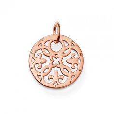Thomas Sabo silver/rose arabesque disc pendant. Gorgeous new disc pendant from the Special Additions collections, smooth polished sterling silver with rose gold plating cut with a beautiful arabesque design. Wear with other items from the Special Additions range for maximum effect. Ref PE430.