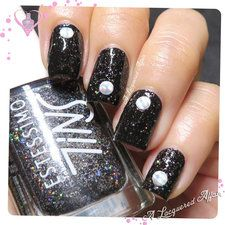 Mani with Holo Metal Studs. #black #glitterpolish #nailart #nails #mani #polish - For more nail looks or to share yours, go to bellashoot.com