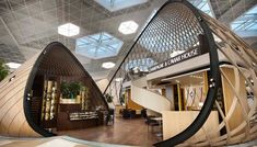 """El diseño de Autoban, galardonado con el prestigioso premio de diseño Red Dot, abarca todos los espacios destinados a los pasajeros de la terminal e incluye unas sorprendentes """"burbujas"""" de madera, construidas utilizando chapa de roble blanco, que crean una sensación de bienvenida y descubrimiento, siendo a la vez espacios para el encuentro o el retiro."""