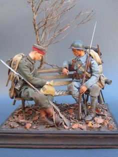 The Game of War by Oscar Hertin - 2 soldiers a French Poilu and a German Landser are fighting on a checkers game board with their respective pieces advancing and retreating as it was in WW1