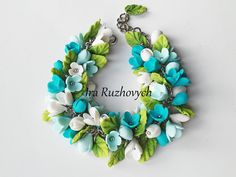 The flower is made from polymer clay, all flowers I make myself. The bracelet size is adjustable between 20cm - 23cm. If you would like the bracelet
