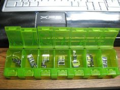 Daily pill box for sewing feet! Neat idea for organizing sewing machine gadgets!