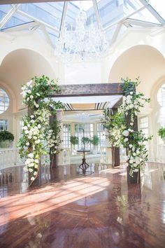 Wooden Chuppah, White Flowers & Greenery | Photography: Eli Turner Studios. Read More:  http://www.insideweddings.com/weddings/ballroom-wedding-with-unique-garden-elements-in-washington-dc/819/