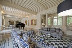 Stately holiday château sitting room, traditional with a modern edge. Self catering Château Garrigue sleeps 15 and has a huge private pool and tennis court. www.purefrance.com/34484