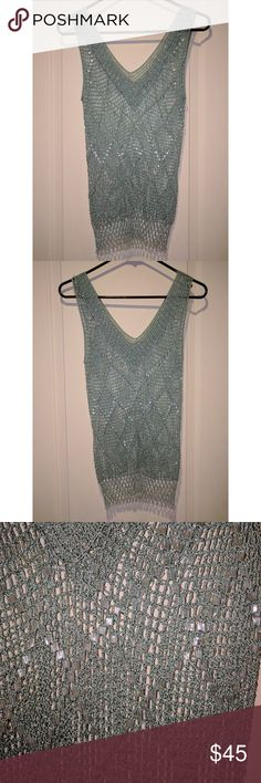 """Mint Sage & Silver Handmade Beaded Crochet Tank Beautiful mint sage and metallic silver beaded crochet tank top, handmade by a local artisan, v-neck, beaded with glass bugle beads and glass seed beads, extremely well made with no flaws, I would call it a small but because it's handmade there's no real size. Shoulder to bottom length-26.5"""", width at bust-11.5"""", width at bottom-12"""", shoulder to armpit length-10"""", v depth-6.75""""🌟 from pet and smoke free home🌟 all reasonable offers accepted 🌟…"""