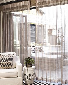 Outdoor fabrics in zany stripes & sheer metallic drapery make this summer indoor/outdoor decor unique.