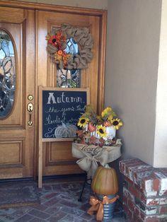 Fall porch including homemade burlap wreath