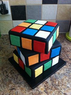 gravity defying 80 s theme rubiks cube and pacman cake kates