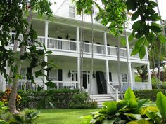 Shutters, stacked on the porch, provide seasonal shelter in Key West. Photograph by Stannate via Flickr.