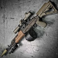 Crazyhorse M1A with EBR Chassis, X Products X14 drum, Leupold MK 4 LR/T riflescope, Surefire SOCOM can, and Atlas bipod