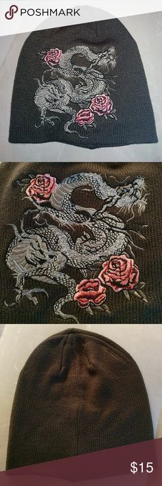🐉 NWOT. Chinese Dragon and pink rose hat NWOT. This is a beautiful gray Chinese dragon with pink roses knit hat. The dragon is sewn with a lot of detail in it. Accessories Hats