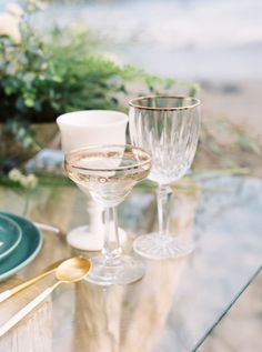 borrowed BLU//glassware...gold rim champagne coupes, gold rim wine #goblets and #milk #glass goblets!!   Photography : This Girl Nicole Photography Read More on SMP: http://www.stylemepretty.com/little-black-book-blog/2016/02/29/boho-california-coast-wedding-inspiration/