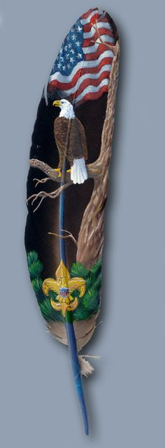 Eagle painted on a feather with Boy Scout emblem. work copyright of Julie Thompson