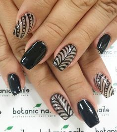 Feather inspired black and white nail art. A wonderful looking nail art design that is unique on its own and will look amazing in any occasion.