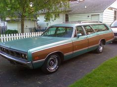 1969 Dodge Monaco Station Wagon .... my dad had the exact same except the hubcaps where different and no roof rack on top.